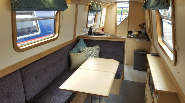 Aqu Vie saloon with table and galley